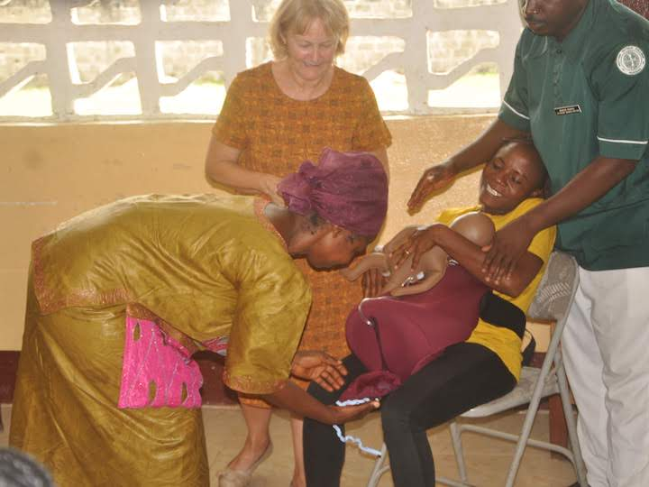 Local midwife, nursing student, and community member participate in birth simulation