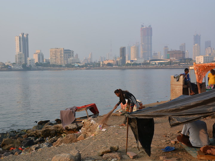 Woman working in front of the Mumbai skyline