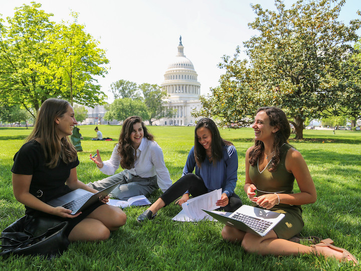 Georgetown students discuss their upcoming meetings with lawmakers on the lawn of the U.S. Capitol