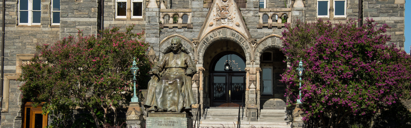 Statue of John Carroll in front of Healy Hall