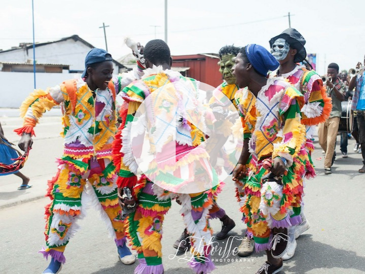 Dancers on the street in celebration of Homowo