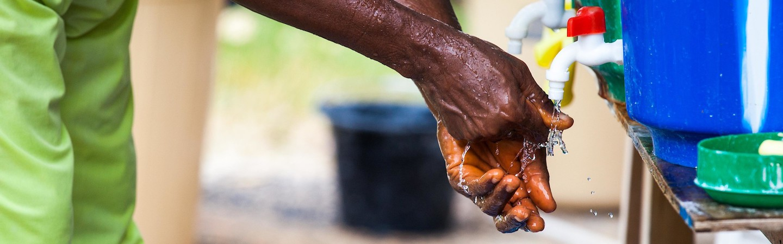 Washing hands over buckets
