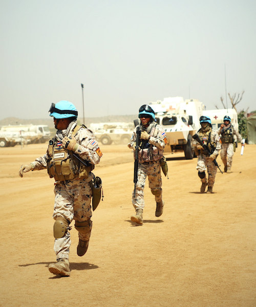 UN Peacekeepers running in desert