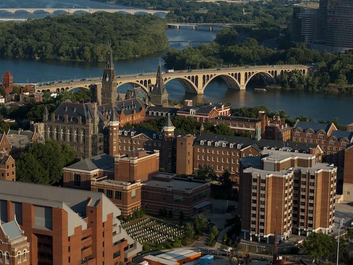 Aerial view of Georgetown University's campus and Key Bridge