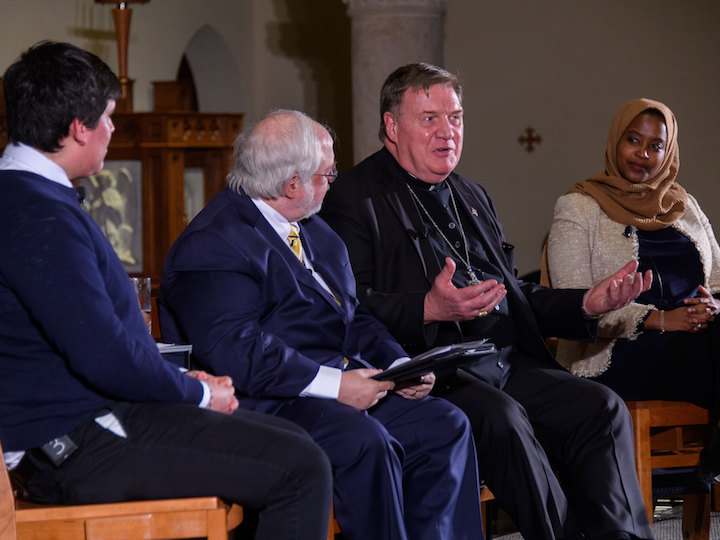 A panel of John Carr, Cardinal Tobin, and Georgetown students