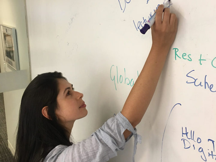 Silvia Rodriguez (MSFS'20) working on a project at Mercy Corps
