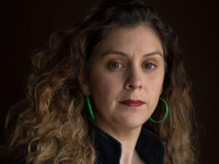 headshot of Laura Peña (L'11)