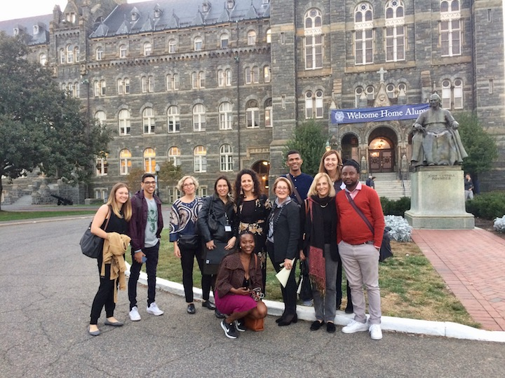 Participants from the conference in front of Healy Hall