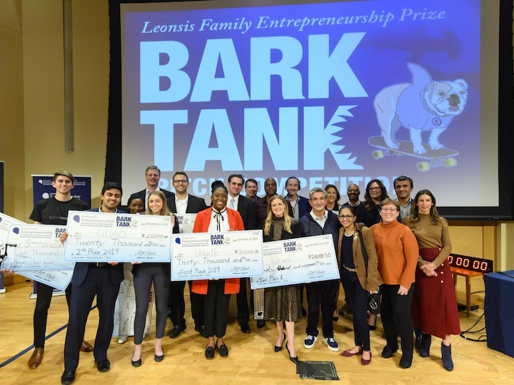 Students showcase their prize money won in the Leonsis Family Entrepreneurship  competition.