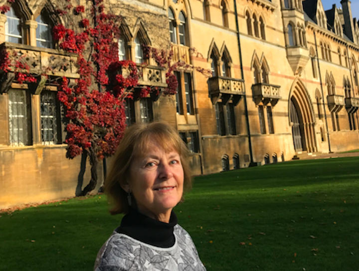 Dr. Cindy Farley poses by Christ Church at Oxford.