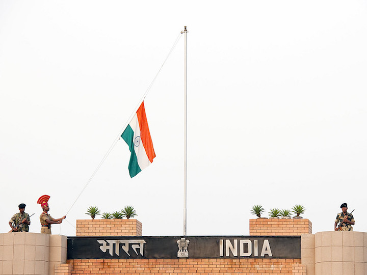 Soldier lowers the Indian flag at the Attari-Wagah border in Kashmir