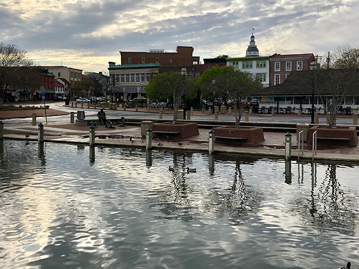 At high tide water almost floods the sidewalk along the Annapolis, Maryland waterfront