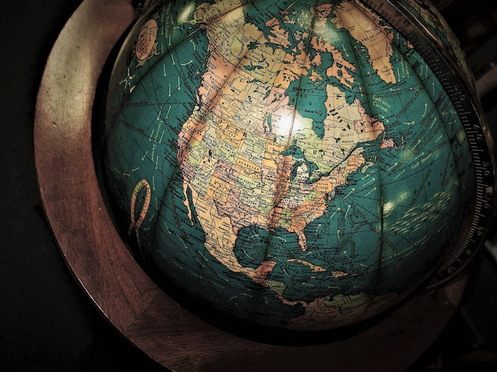 This is a picture of globe in the dark. It focus on the United States.