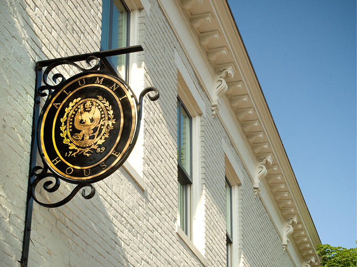 Alumni House sign featuring the Georgetown University seal