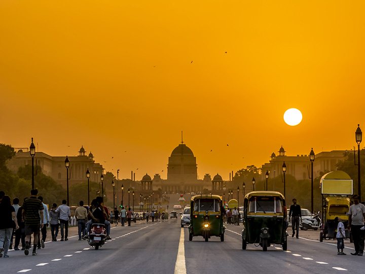 Street in front of India's presidential palace at sunset