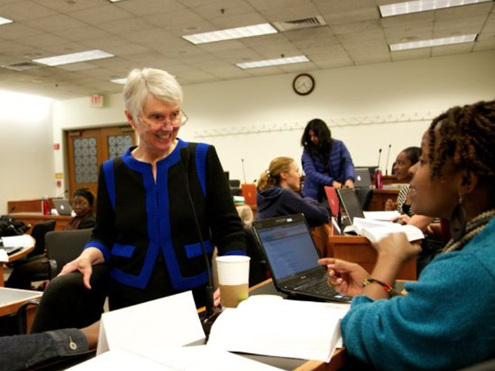 Susan Deller Ross in a classroom with students