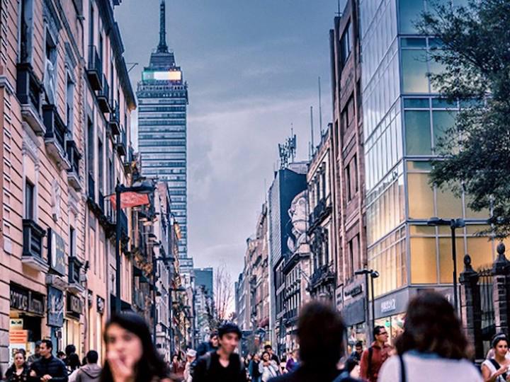 People walking amid skyscrapers
