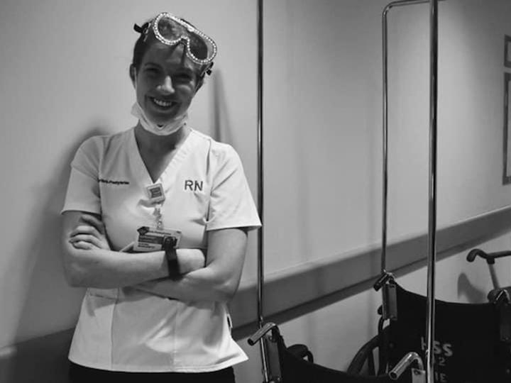 Maggie Raymond in nurse's scrubs