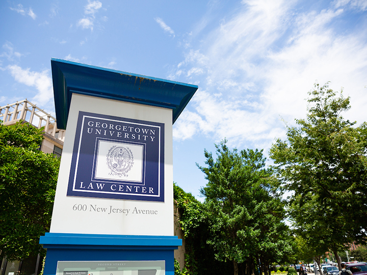 "Exterior campus sign: ""Georgetown University Law Center, 1600 New Jersey Ave"""