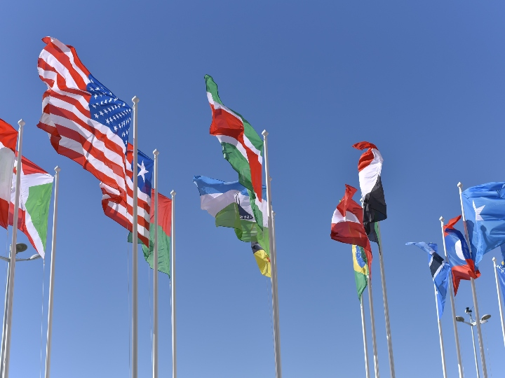Multiple flag poles with different national flags