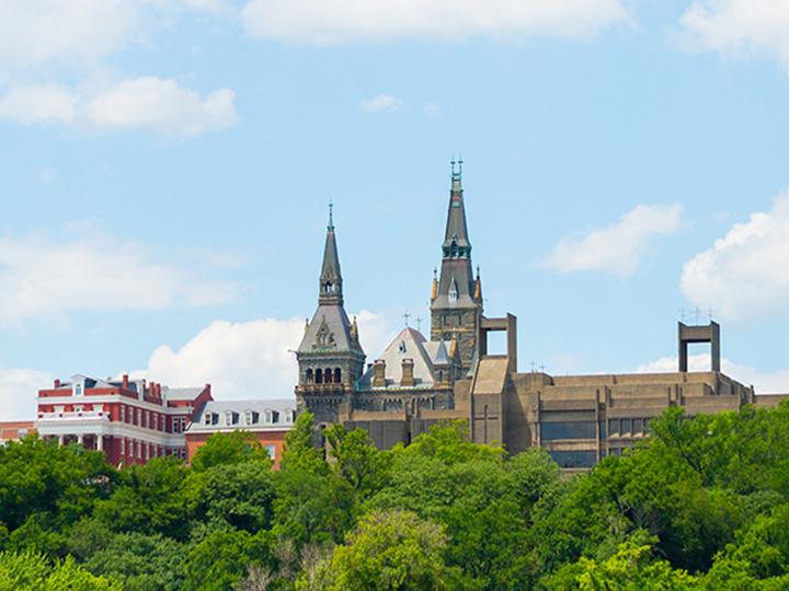 Georgetown University campus skyline viewed from the Key Bridge