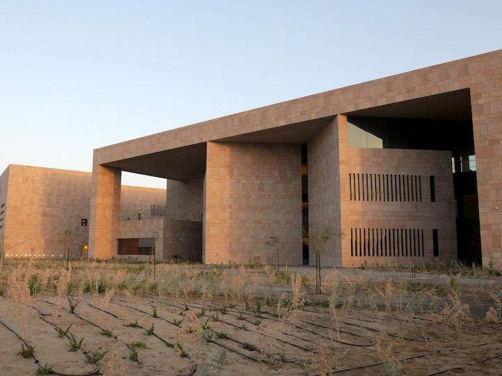 Tan stone building on campus of Georgetown University - Qatar
