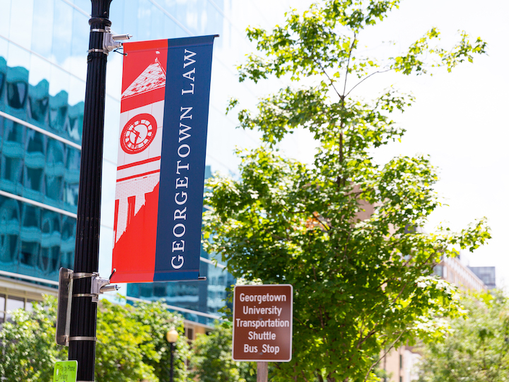 Georgetown University Law Center Banner hanging from a Lamppost