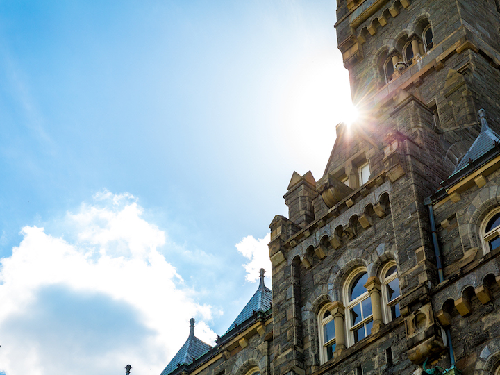 Healy Hall framed by a Blue Sky and Sun Flare