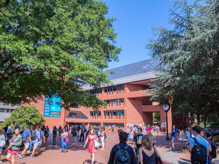 Students walking in Georgetown's Red Square on a sunny day