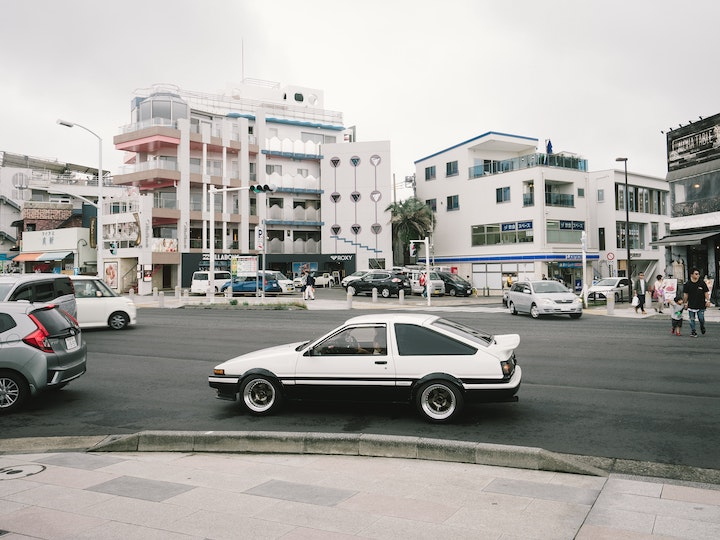 White Toyota stopped on a Japanese Street