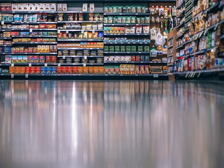 Packaged foods on the shelves of a grocery store