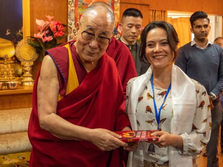 Lorena Gomez with the Dalai Lama