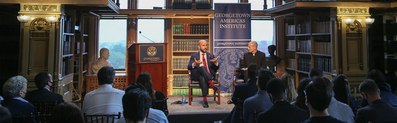 NSC Official Juan Gonzalez and Rev. Matthew Carnes, S.J., in conversation
