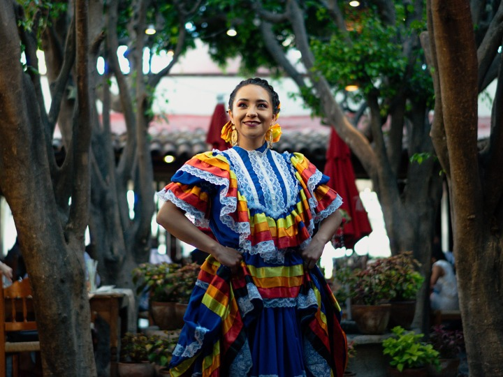 Mexican Woman in Traditional Dress in a Park