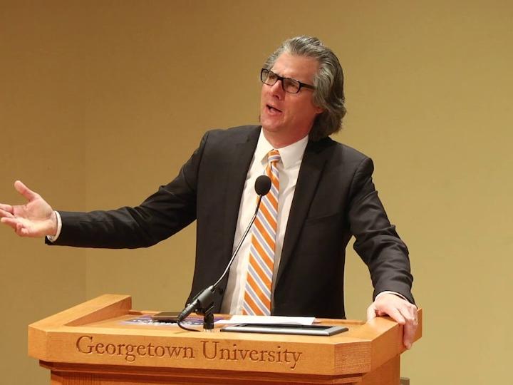 Keir Leiber speaking at a Georgetown University podium.