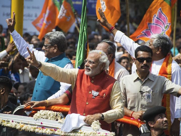 Indian men waving flags