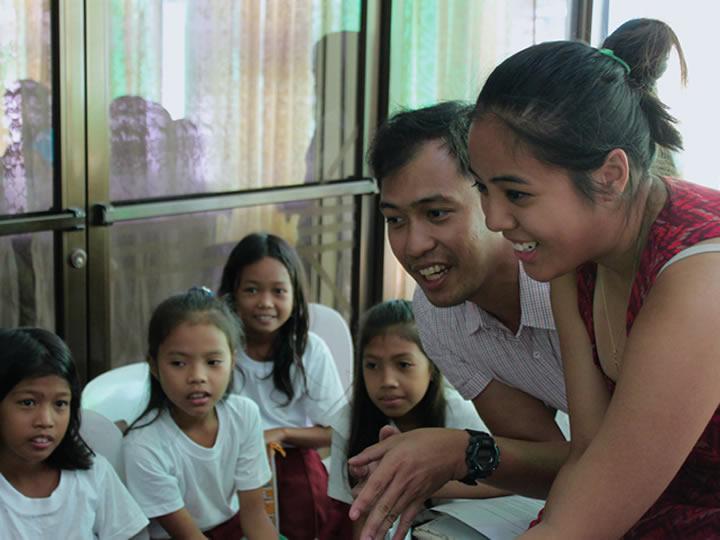 GU Impacts fellows teaching children