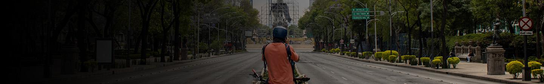Man on bicycle in empty Paseo de la Refoma in Mexico City