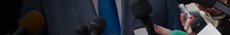 Hands holding microphones.