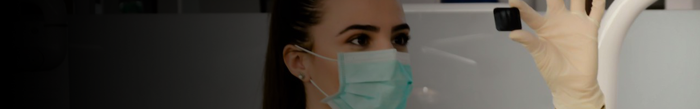 Woman in lab wearing surgical mask