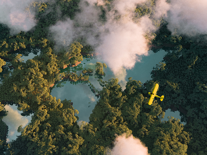 Yellow plane flies through clouds above a forest