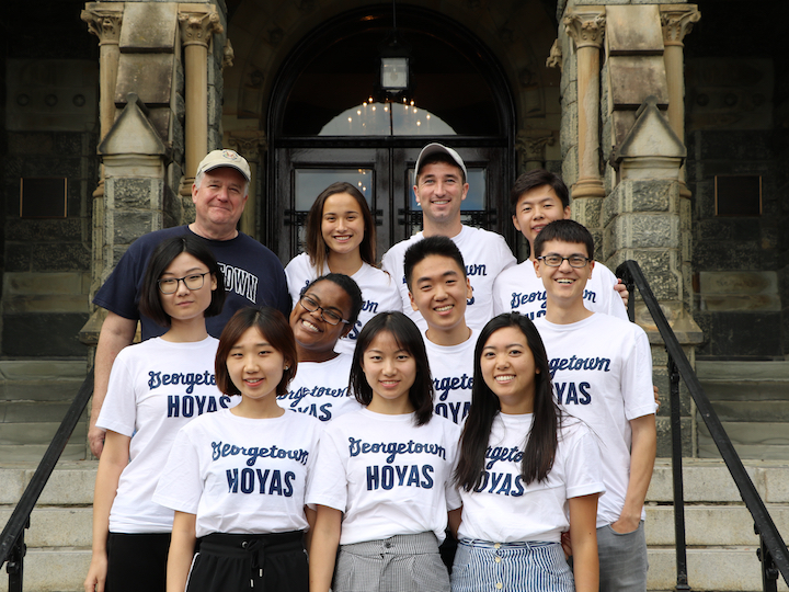 2017-2018 Student Fellows in front of Healy Hall.