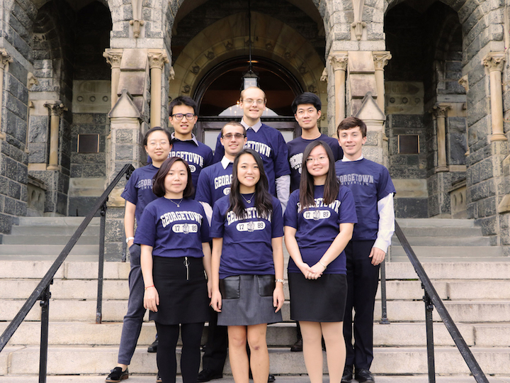 2016-2017 Student Fellows in front of Healy Hall.