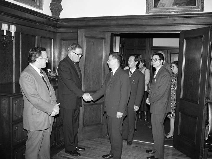 Chinese scholars being greeted by Georgetown President Timothy S. Healy, S.J.