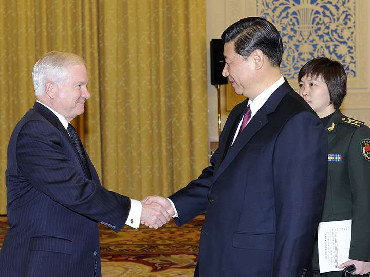Robert Gates shaking hands with then China vice president Xi Jinping