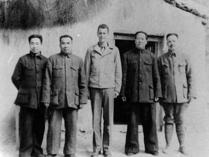 Raymond P. Ludden is standing with Chairman Mao Zedong and Premier Zhou Enlai and Marshal Zhu De  in Yan'an.