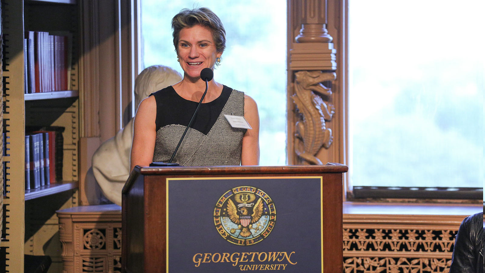 Maeve McKean talking at a conference at Georgetown University