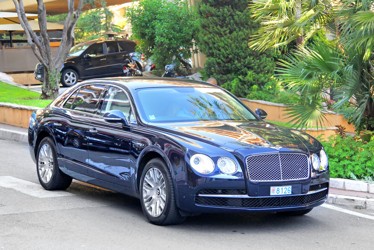 Monte Carlo, Monaco - August 2, 2014: British luxury car Bentley Continental Flying Spur drives at the city street near the casino.