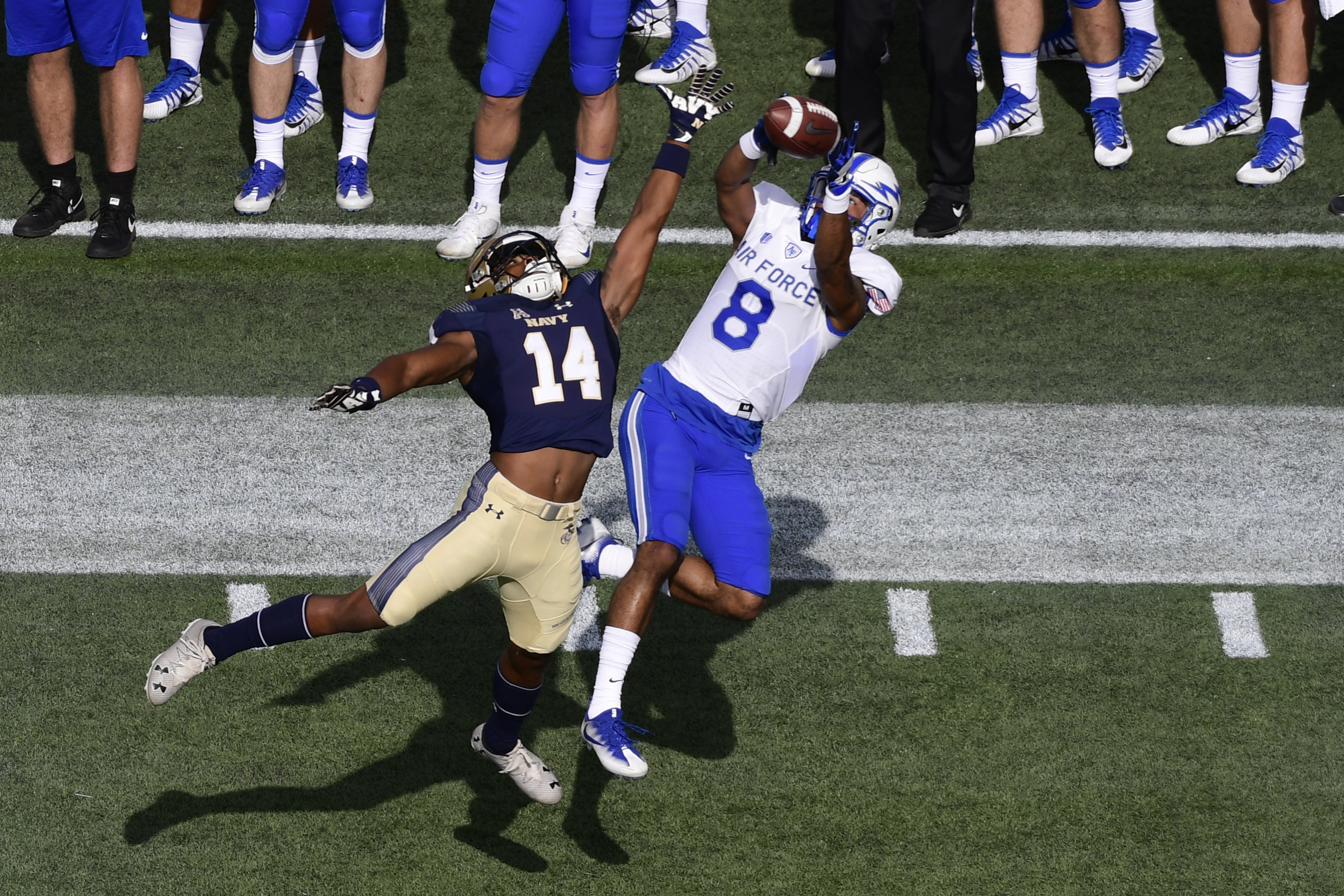 Air Force Falcons wide receiver Marcus Bennett (8) catches a pass over  Navy Midshipmen cornerback Elijah Merchant (14) during the first quarter at Navy-Marine Corps Memorial Stadium. Tommy Gilligan-USA TODAY Sport