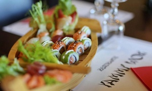 Cena multietnica con sushi e carne in formula All you can eat per 2 persone al ristorante Yammy Wok (sconto fino a 34%)